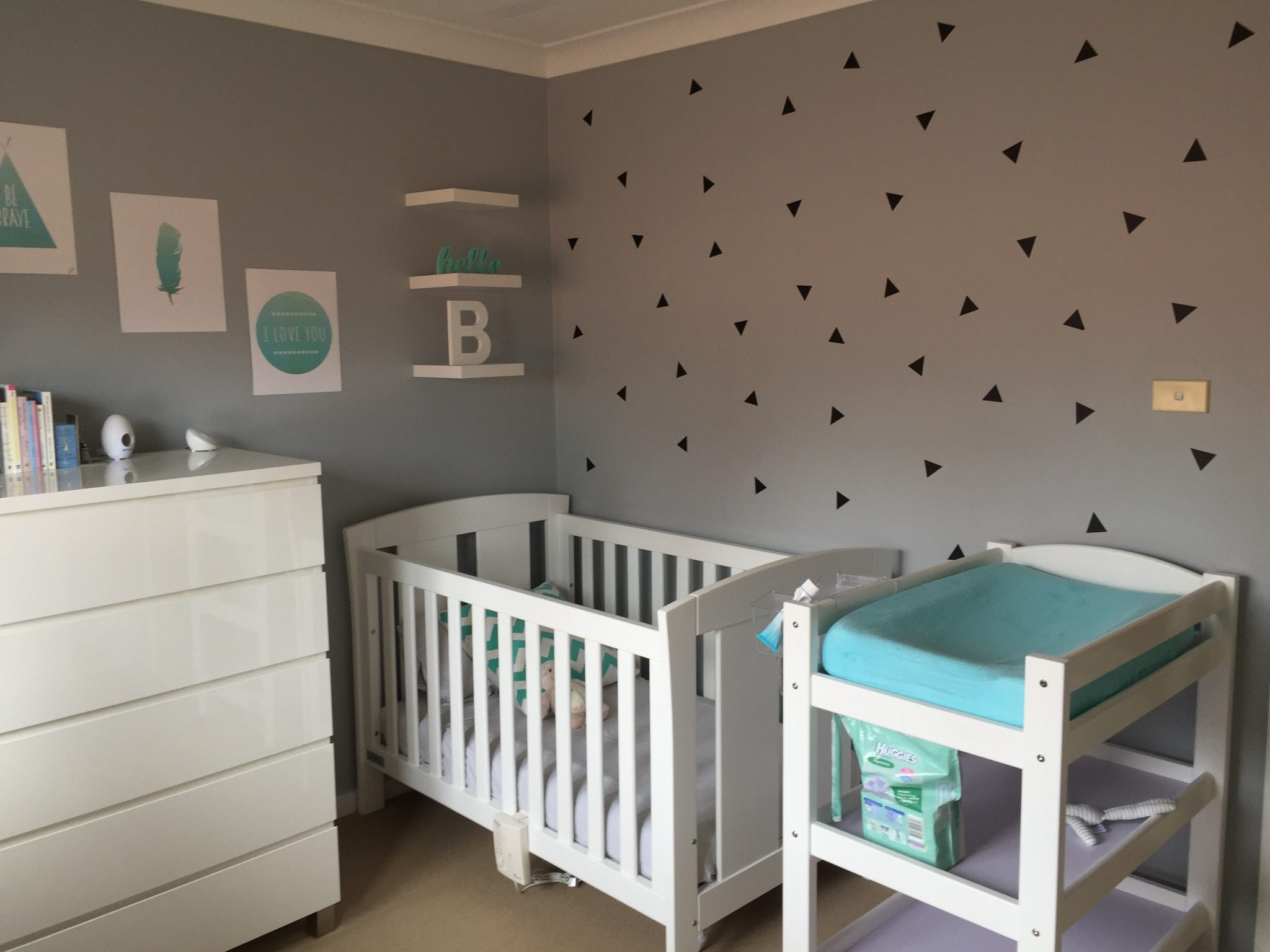 Best Remending removable wall decals as an affordable and on trend way to style a nursery Nicole also highlights funky book ledges storage that can be