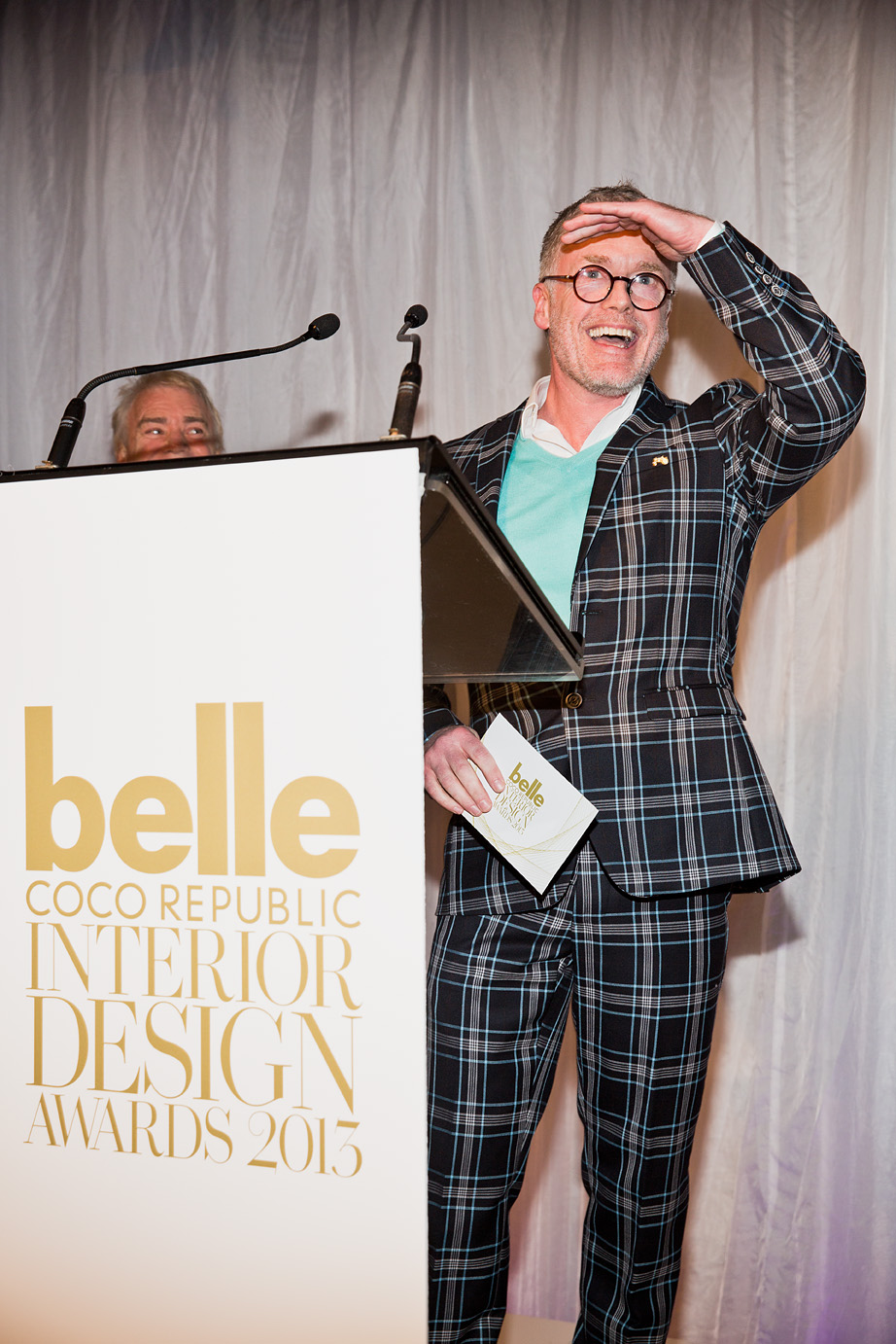 A delighted Paul Hecker collects the interior designer of the year award on behalf of himself and business partner Hamish Guthrie, who couldn't be there because his wife is due to give birth very soon!