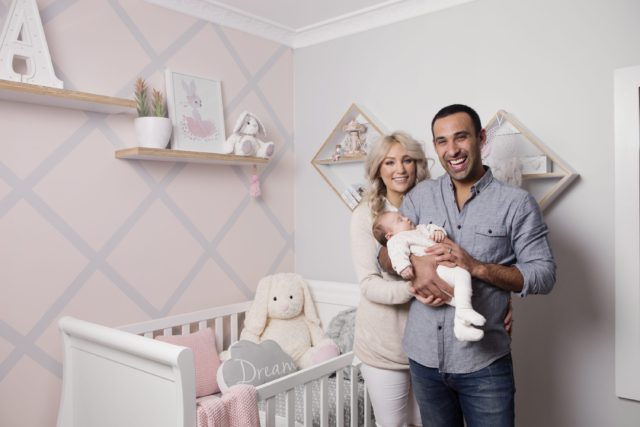 adam-and-lisa-hold-arabella-infront-of-the-bebe-care-imperio-cot-bed
