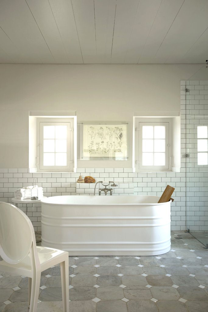 bathroom on a budget: stock tank bathtubs - the interiors addict