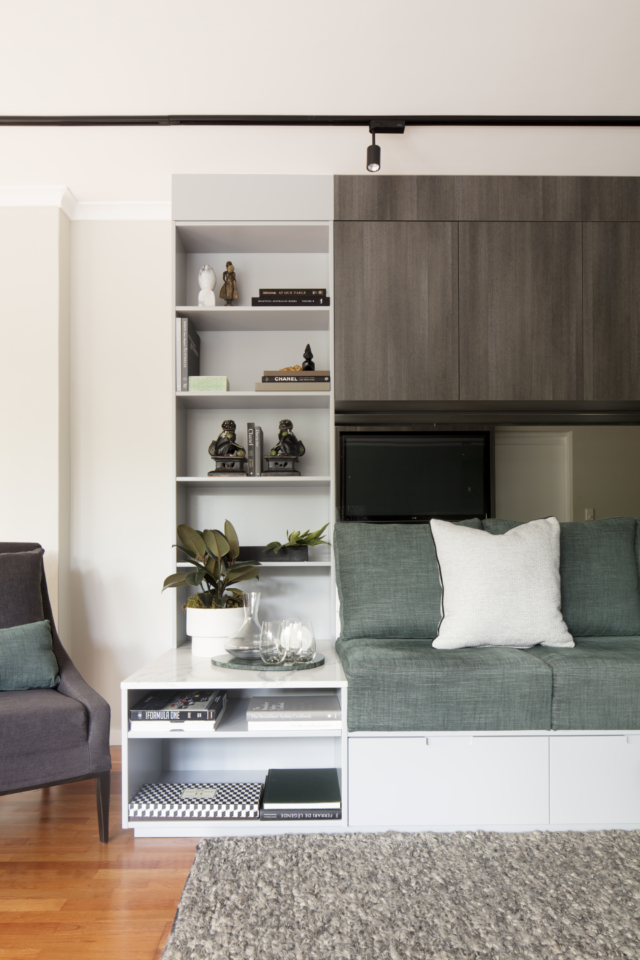 The new living room features fabulous built-in storage and seating