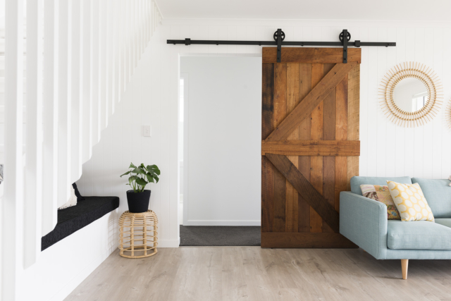 The custom designed reclaimed barn door was one of the build's special splurges