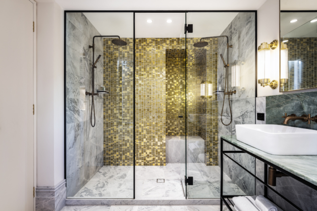 These unexpected gold tiles in the bathroom evoke a Gustav Klimt painting.