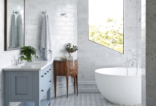 Modern bathroom accessorised with antiques