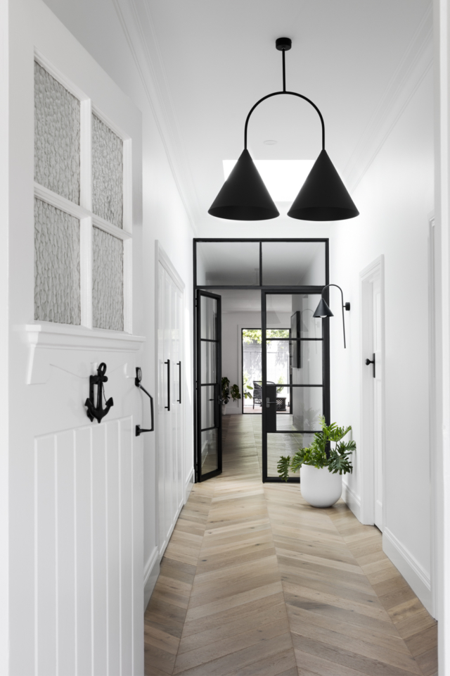 Black door frames separate the old and new parts of the home