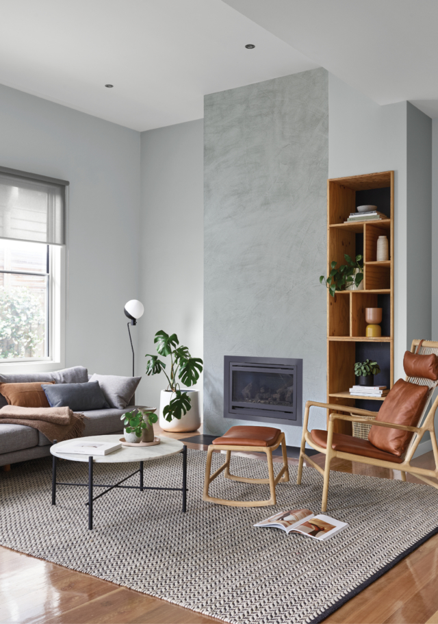 Dulux 'Concrete Effect' in 'Pale Elements' creates the textural effect of polished concrete on the fireplace in this room.