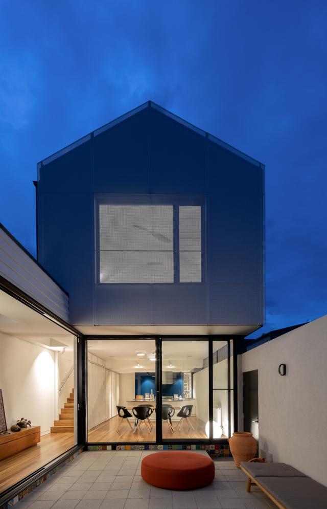 A perforated steel gable provides privacy to the upper level
