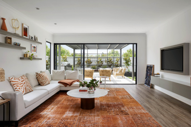 A burnt orange rug features in Henley's 'Marlo' display home