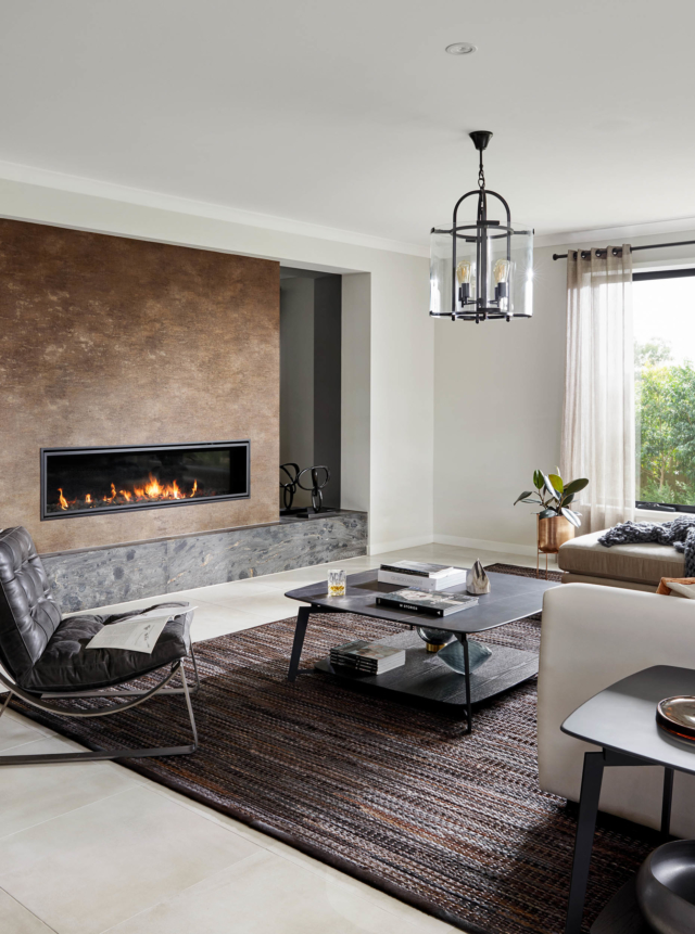 A rug helps to anchor the lounge room at Henley's Sahara display home