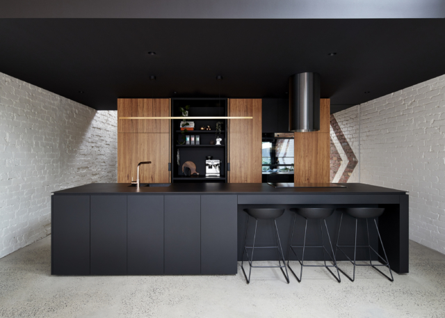 The kitchen appliances are cleverly hidden behind stylish cabinetry