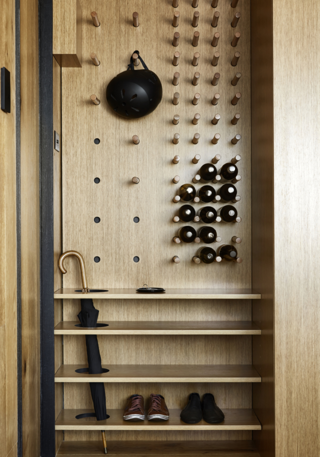 Multipurpose storage at the entry houses coats, shoes a wine rack and even an umbrella stand