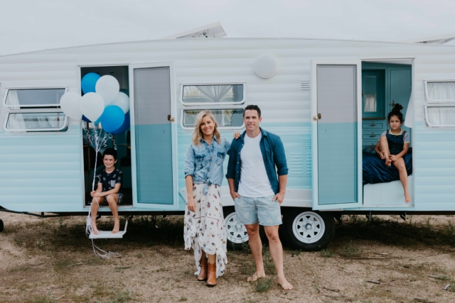 Carlene and Michael Duffy in front of their latest caravan renovation 'Dolly'