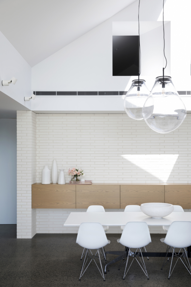 The bricks are beautifully offset by minimalist floating joinery in the dining area