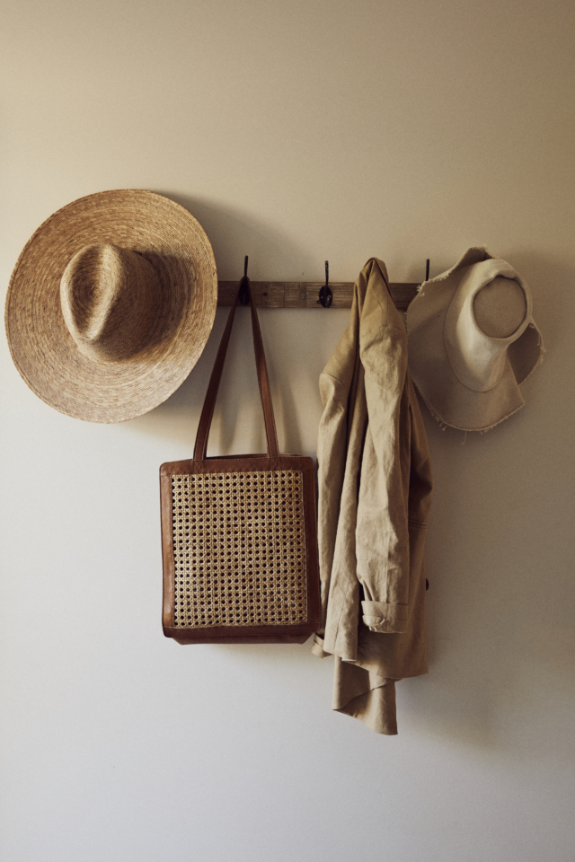 A coat rack features St Agni.'s best selling 'Hennie' rattan bag