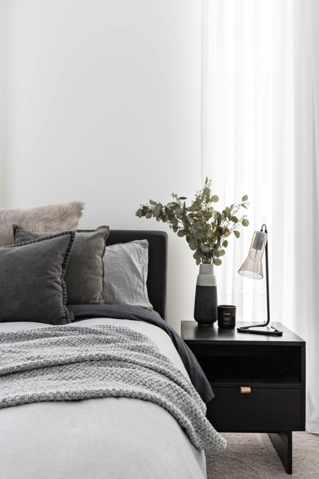 The guest room has a relatively breezier feel courtesy of layers of light grey bed linen.