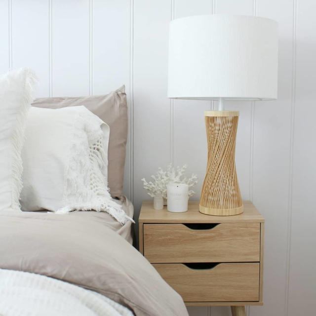 A Kmart bedside looks rather luxe when paired with a Beacon Lighting lamp and a piece of Darren Palmer Collection coral from Myer