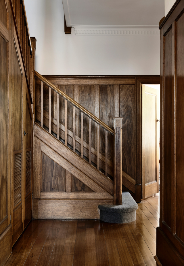 The kitchen takes its timber cues from this original staircase