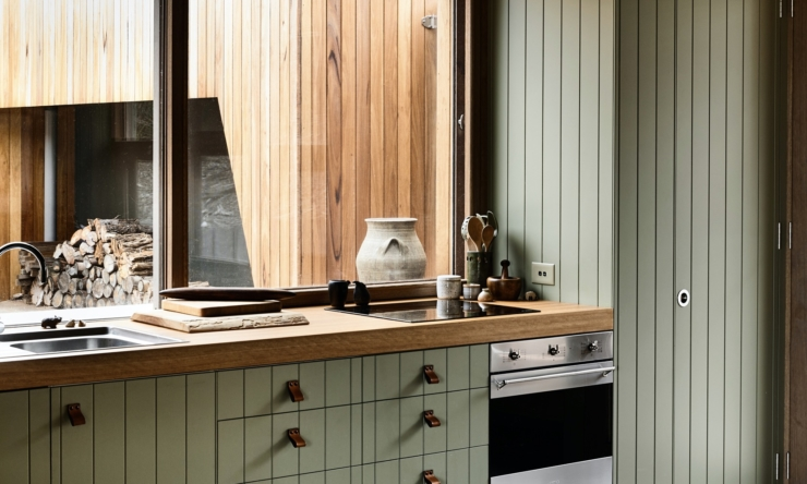 Green timber panels star in celebrated coastal home