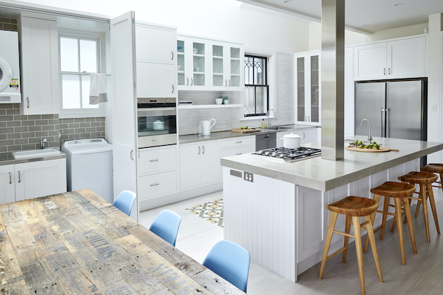 Designed by Dominique, this kitchen features a laundry in an adjacent area