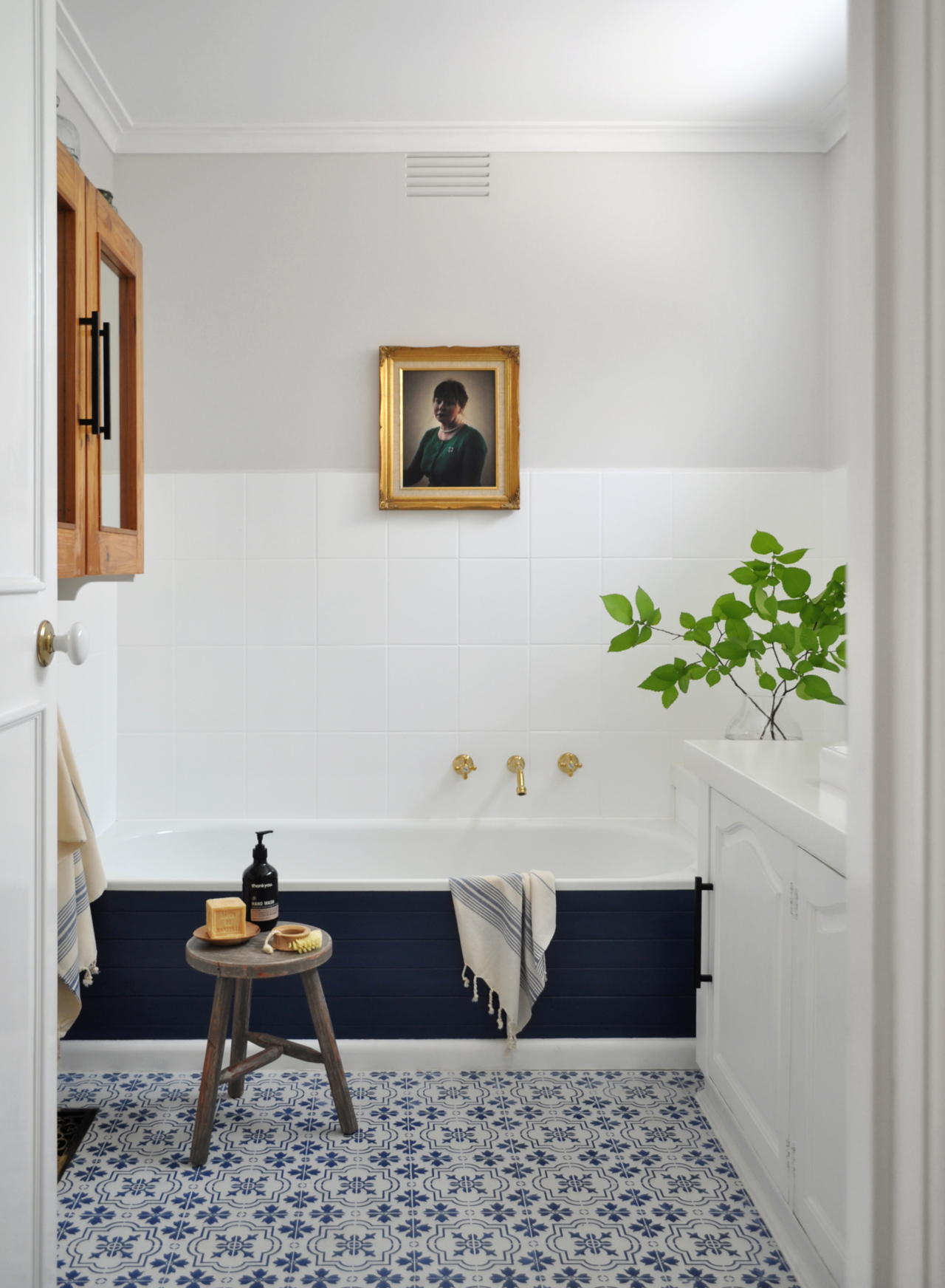 The Painted Hive used tile paint to overhaul this bathroom in an incredible way