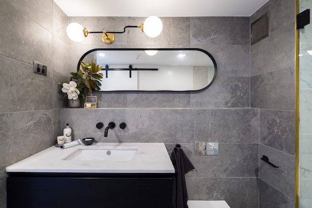 The feature light, from Montauk Lighting Co., and mirror are a highlight of the bathroom