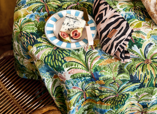 Seen here is a 'Colombo' print table cloth with 'Zebra' print napkin