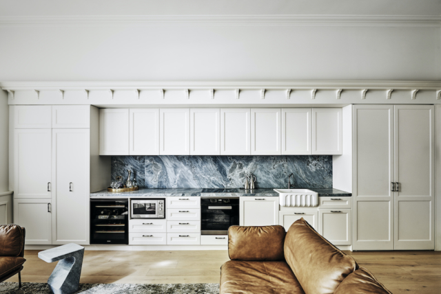 Kitchen: The stone benches are by CDK