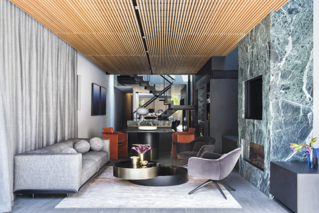 The home's lounge and kitchen takes in the home's statement staircase