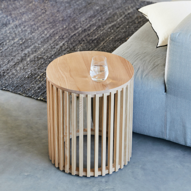 We love this slatted timber side table